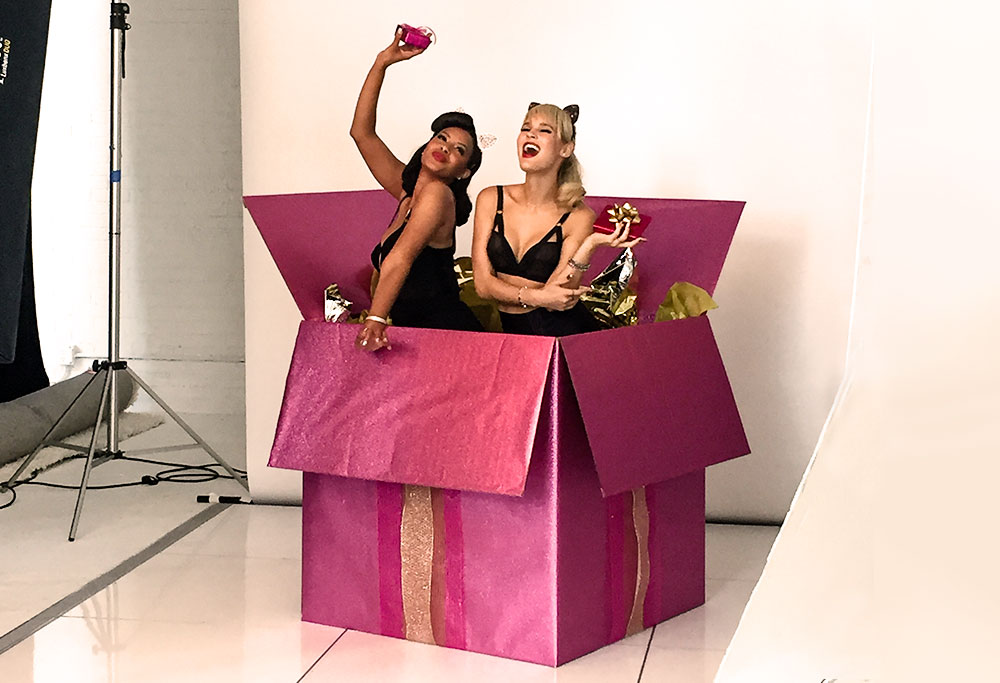 Vanessa and Joy having fun in giant present box