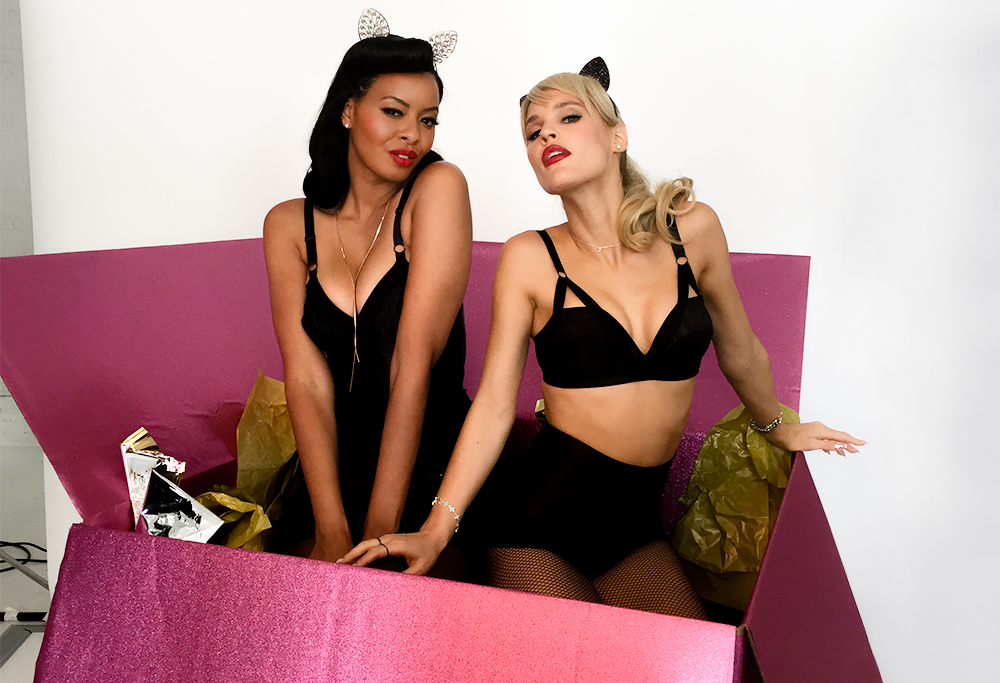 Joy and Vanessa posing in present box wearing hermatite bling cat ears